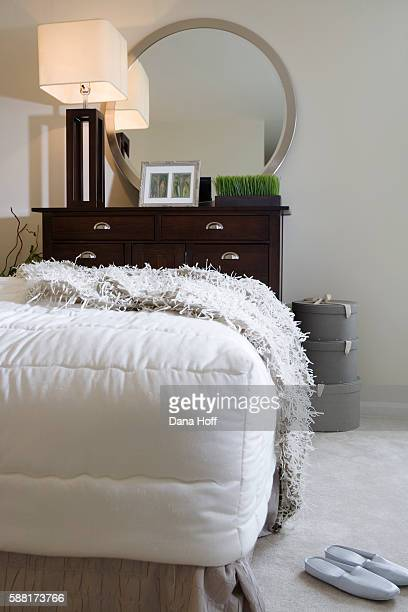 Foot of Bed with Throw by Chest of Drawers