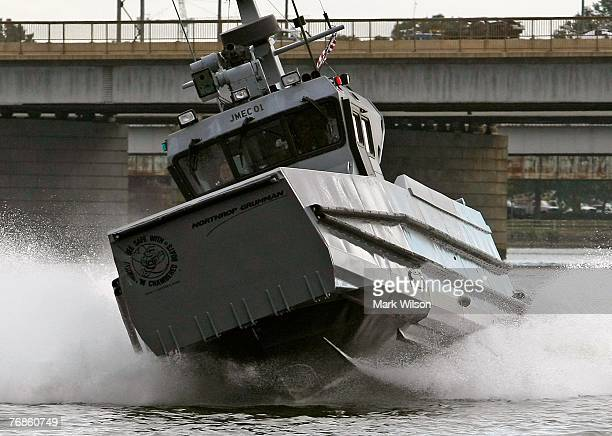 A 41 foot prototype boat named the Joint Multimission Expeditionary Craft demonstrates a maneuver on the Potomac River during a demonstration...
