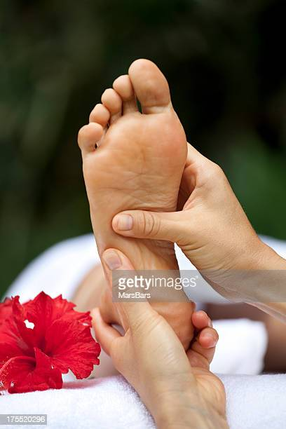 foot reflexology massage at a spa - reflexology stock photos and pictures