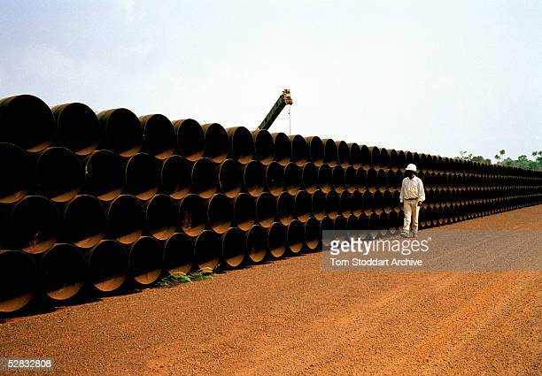 40 foot sections of pipeline which will carry oil from the landlocked oil fields of Chad through the jungles of Cameroon to the Gulf of Guinea The...