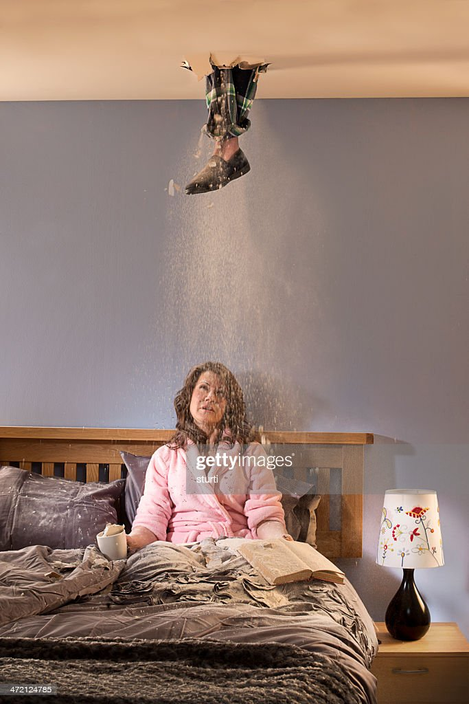 foot through ceiling : Stock Photo