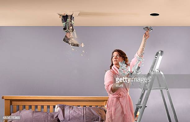 foot through ceiling - women in slips stock photos and pictures