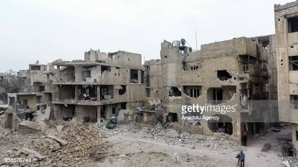 A footage captured by an unmanned aerial vehicle shows wreckages of structures of Arbin town which has been under siege of Assad Regime in Arbin town...