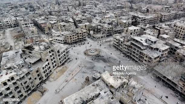 Footage captured by an unmanned aerial vehicle shows wreckages of structures of Arbin town, which has been under siege of Assad Regime, in Arbin town...