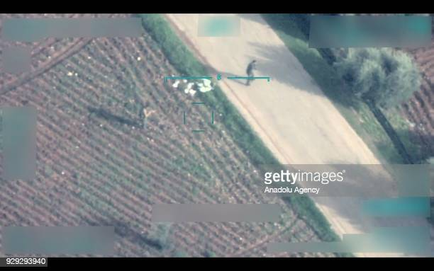 A footage captured by Turkish unmanned aerial vehicle on March 5 2018 shows one of two YPG/PKK terrorist group members planting improvised explosives...