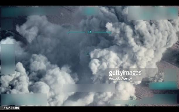 A footage captured by Turkish unmanned aerial vehicle on March 5 2018 shows smoke rising after Turkish Armored Forces hit positions of two YPG/PKK...