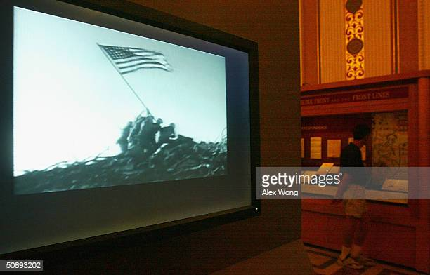 Footage of the scene of US Marines raising a US flag at Iwo Jima during World War II is played at the newly opened From the Home Front and the Front...