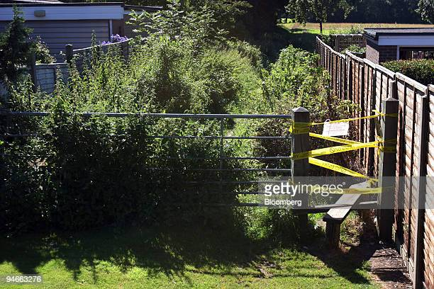 Foot-and-mouth sign closes access to a public footpath close to the contaminated farm at Wanborough, Surrey, U.K., on Saturday, Aug. 4, 2007. The...