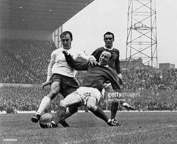 Football 12th August 1967 English League Division One Manchester United 3 v Tottenham Hotspur 3 Manchester United's Nobby Stiles tackles Tottenham...