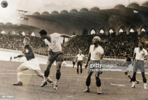 Football 12th June 1938 Bordeaux France World Cup Finals QuarterFinal Brazil 2 v Yugoslavia 1 A Brazilian defender heads clear from a Yugoslav...