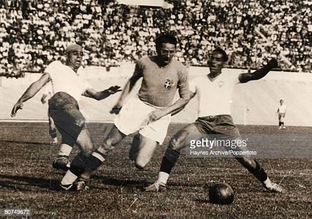 Football 16th June 1938 World Cup Finals Marseille France SemiFinal Italy 2 v Brazil 1 Italy's Silvio Piola bursts through Brazil's Machado and...