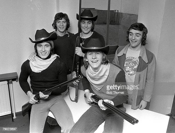 Football 17th December 1974 Manchester United players dressed up in cowboy gear and holding doublebarrelled shotguns for a Christmas party They are...