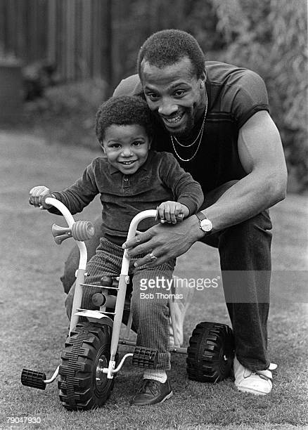 Football 18th October 1982 West Bromwich Albion and England footballer Cyrille Regis playing with his son Robert in the garden of their home