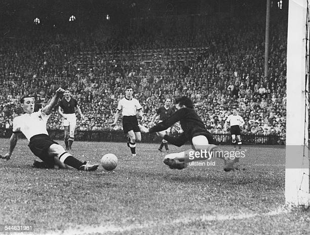 Football 1954 FIFA World Cup Final in Berne Switzerland Germany vs Hungary 32 scene of the match 12 goal by Max Morlock against Hungarian goalkeeper...