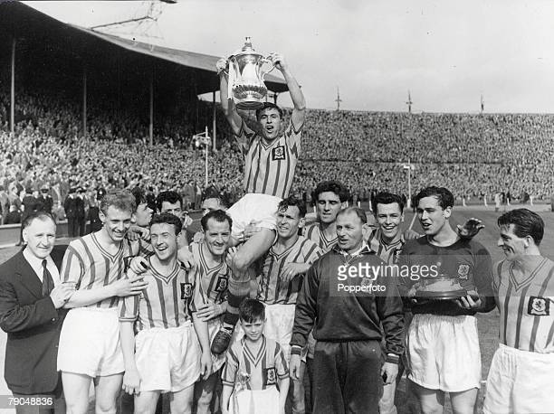 Football 1957 FA Cup Final Wembley London Aston Villa 2 v Manchester United 1 4th May Aston Villa captain Johnny Dixon lifts the trophy while he is...