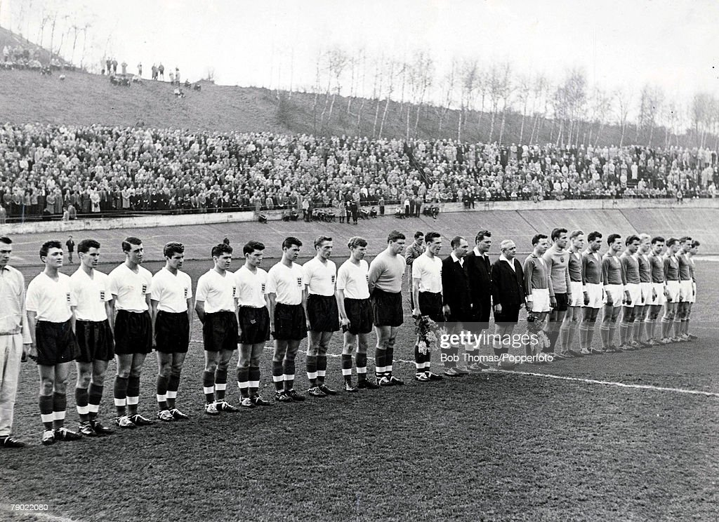 Football. 1958-59. Zwickau, East Germany. Youth International. East Germany 4 v England 3. The teams line-up for the National Anthems before kick-off. Geoff Hurst (3rd left) played at Centre-half for England. : News Photo