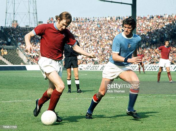 Football 1960s Manchester City's Mike Doyle keeps an eye on Burnley attacker Leighton James