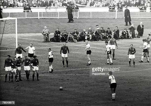 Football 1966 World Cup Final Wembley Stadium London 30th July England 4 v West Germany 2 England players form a wall as West Germany prepare to take...