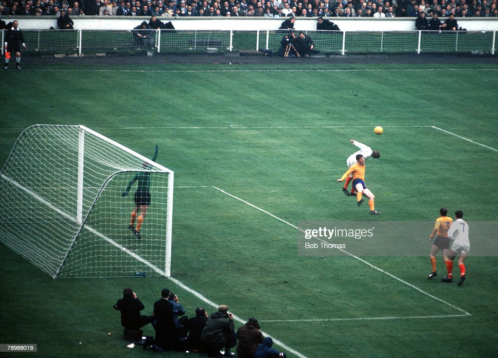 Football, 1968 FA Cup Final, Wembley Stadium, 18th May, 1968, West Bromwich Albion 1 v Everton 0, An Everton defender and WBA attacker jump up for the ball in the Everton penalty area