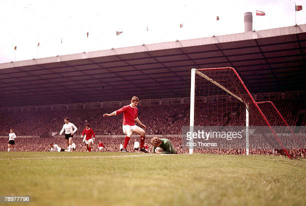 Football 196970 Manchester United v Sunderland Manchester Uniteds Brian Kidd stands over Sunderland goalkeeper Jim Montgomery