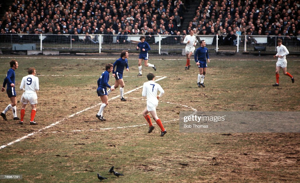 Football. 1970 FA Cup Final. Wembley. 11th April, 1970. Chelsea 2 v Leeds United 2. Action during the match showing pigeons feeding on the terrible Wembley pitch. : News Photo