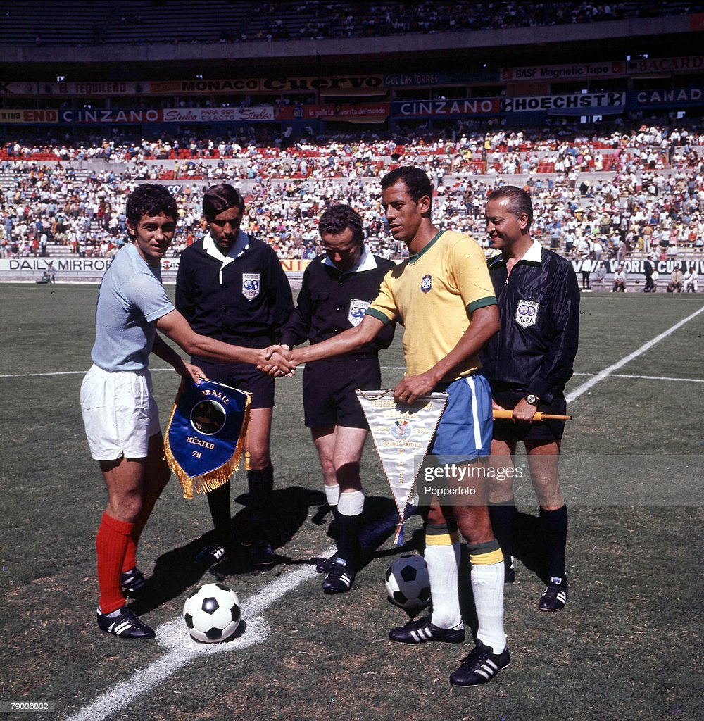 Football. 1970 World Cup Finals. Guadalajara, Mexico. 10th June, 1970. Brazil 3 v Romania 2. Brazilian captain Carlos Alberto shakes hands with the Romanian captain during the exchange of pennants before the match. : News Photo