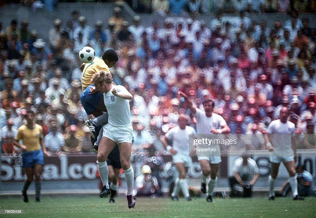 Football. 1970 World Cup Finals. Guadalajara, Mexico, 7th June, 1970. England 0 v Brazil 1. England captain Bobby Moore challenges Brazil's Jairzinho for the ball in the air. : News Photo