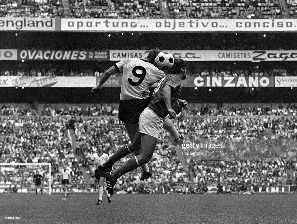 Football, 1970 World Cup Semi Final, Azteca Stadium, Mexico, 17th June 1970, Italy 4 v West Germany 3, West Germany+s Uwe Seeler jumps up to head the ball with Italy+s Antonio Juliano during the match : News Photo