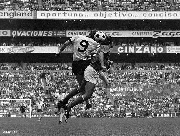Football, 1970 World Cup Semi Final, Azteca Stadium, Mexico, 17th June 1970, Italy 4 v West Germany 3, West Germany+s Uwe Seeler jumps up to head the...