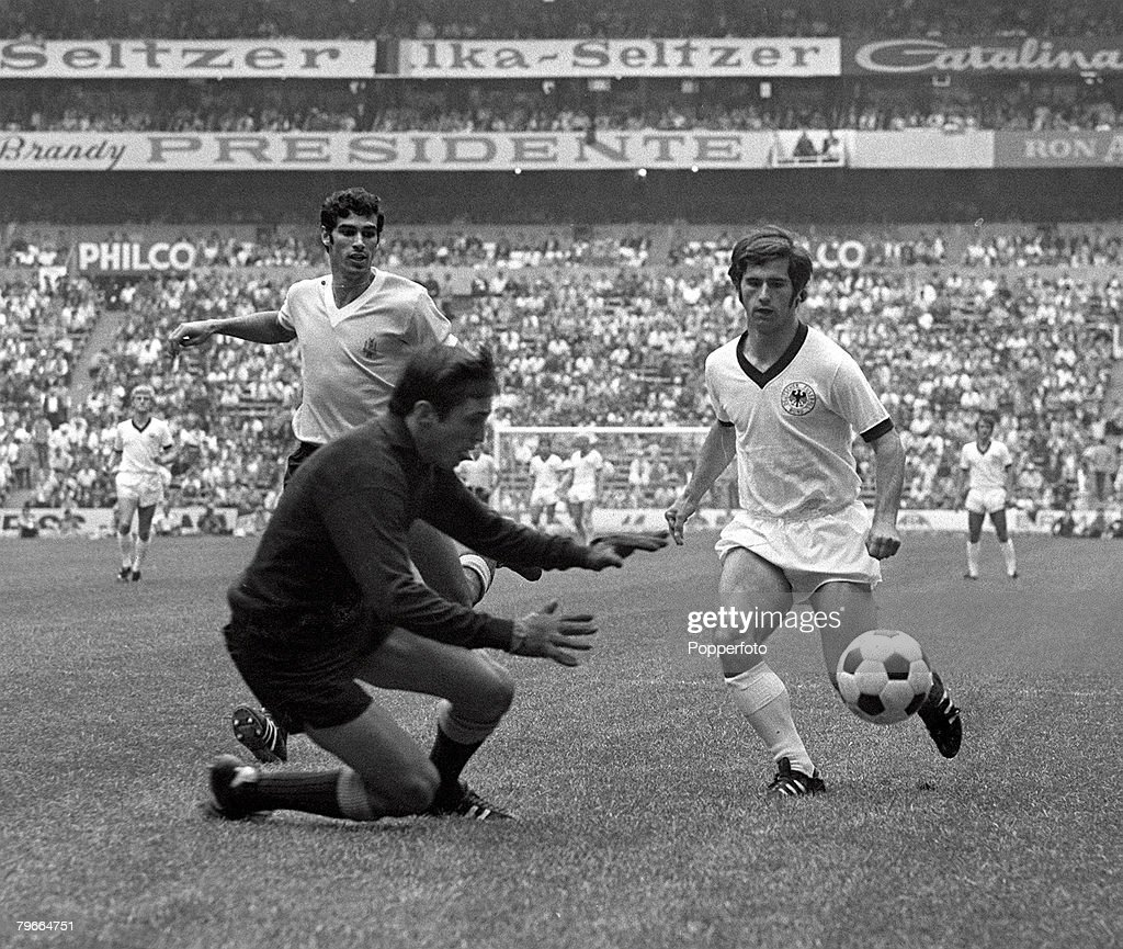 Football, 1970 World Cup Third Place Play-Off, Azteca Stadium, Mexico, 20th June 1970, West Germany 1 v Uruguay 0, Uruguayan goalkeeper Ladislao Mazurkiewicz saves at the feet of West German striker Gerd Muller watched by Atilio Ancheta (left) during the match