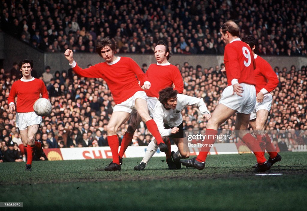 Football, 1970's, A group of Manchester United players including Bobby Charlton (right) and Nobby Stiles crowd out a Derby County player during their league match