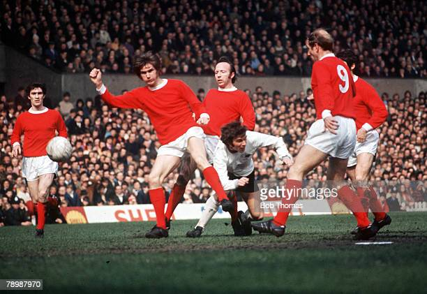 Football 1970's A group of Manchester United players including Bobby Charlton and Nobby Stiles crowd out a Derby County player during their league...