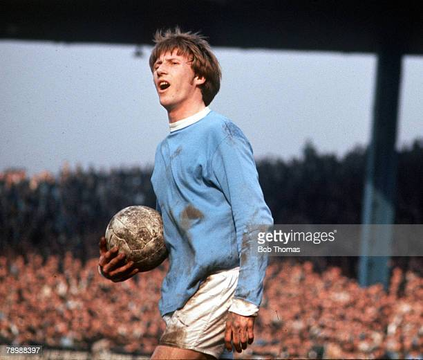 Football 1970's Manchester Citys Colin Bell protesting a decision as he holds the ball in his hand