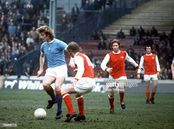 Football 1970's Manchester City's Rodney Marsh on the ball surrounded by Arsenal players