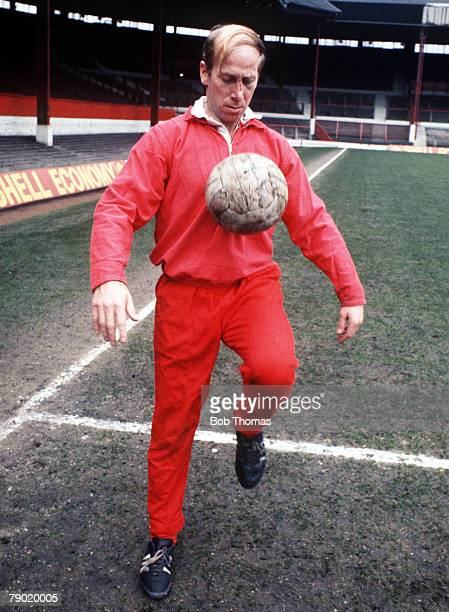 Football 1970's Manchester United's Bobby Charlton using his body to control the ball during practice in training