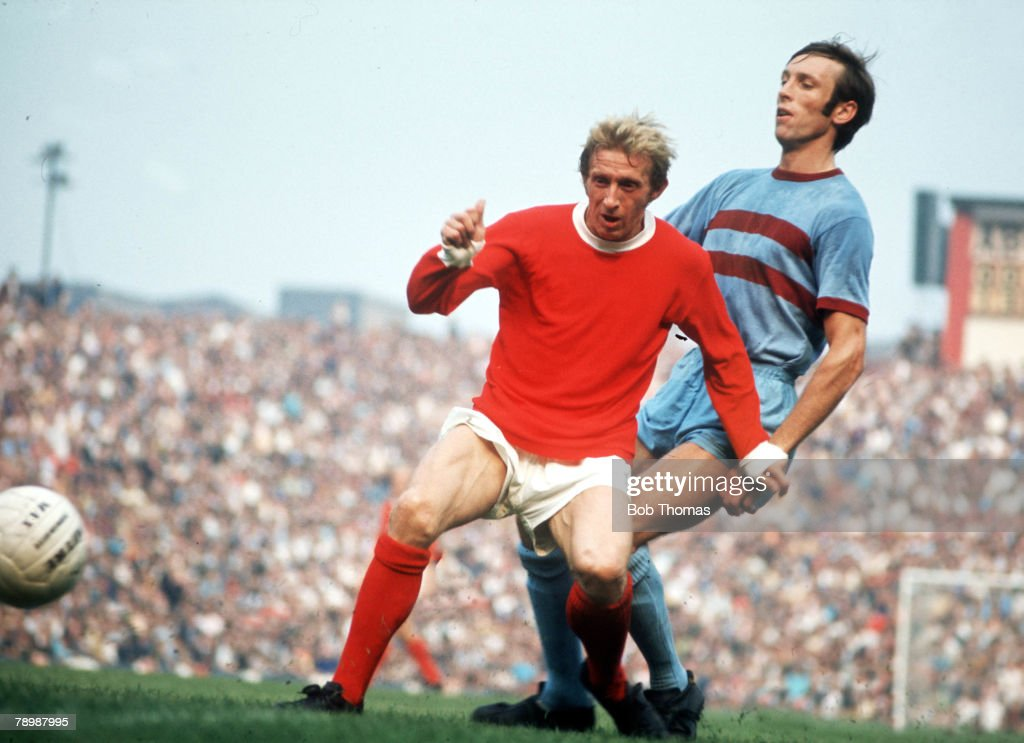 Football, 1970's, Manchester United's Denis Law on the ball watched by West Ham United's Alan Stephenson during their match at Old Trafford