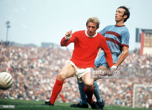 Football 1970's Manchester United's Denis Law on the ball watched by West Ham United's Alan Stephenson during their match at Old Trafford