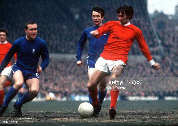 Football 1970s Manchester Uniteds George Best in action for United against Chelsea watched by Ron 'Chopper' Harris