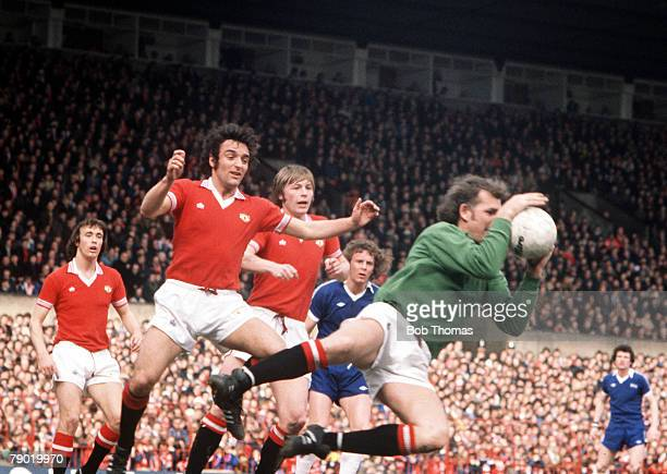Football 1970's Manchester United's goalkeeper Alex Stepney dives out of his goal to claim the ball in a crowded United penalty area during a league...