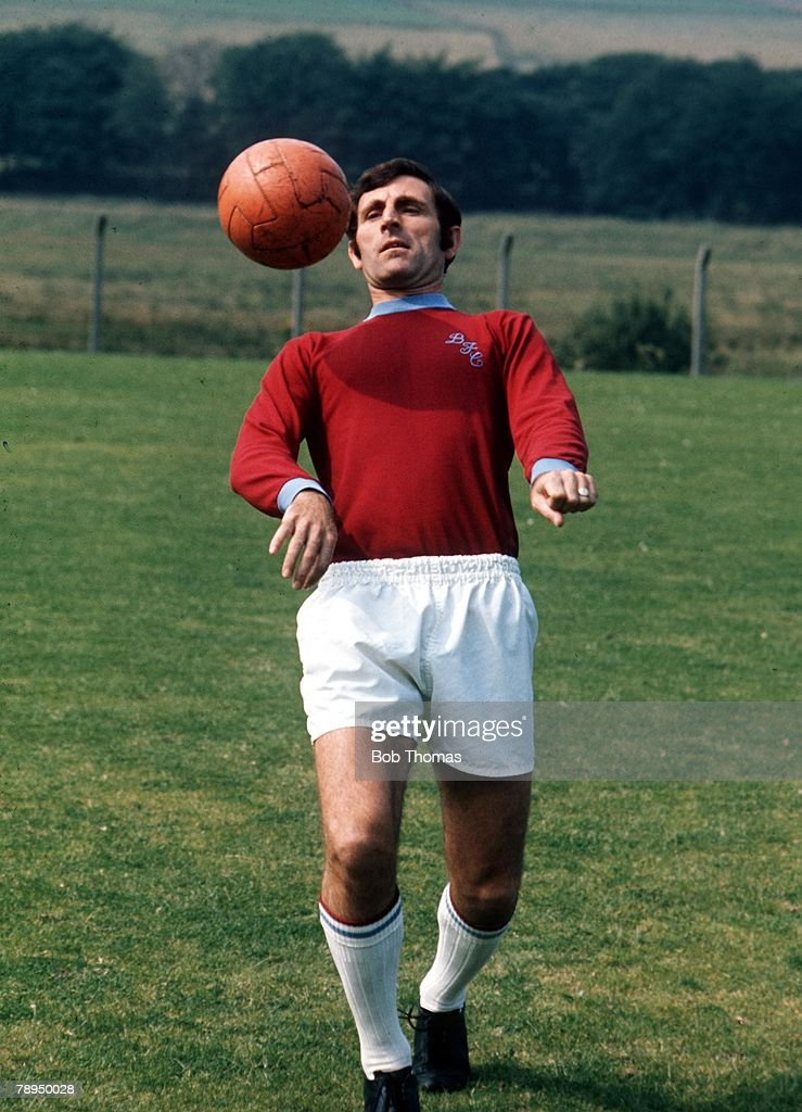 Football. 1971 - 1972. Burnley defender John Angus practices his ball control skills during a training session. : News Photo