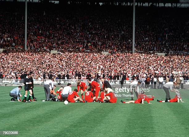 Football 1971 FA Cup Final Wembley 8th May Arsenal 2 v Liverpool 1 Liverpool players rest at the end of ninety minutes before the start of extra time