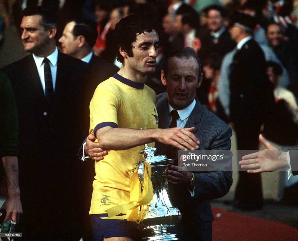 Football. 1971 FA Cup Final. Wembley. 8th May, 1971. Arsenal 2 v Liverpool 1. Arsenal's captain Frank McLintock receives handshakes as he receives the FA Cup trophy, completing an historic double. : News Photo