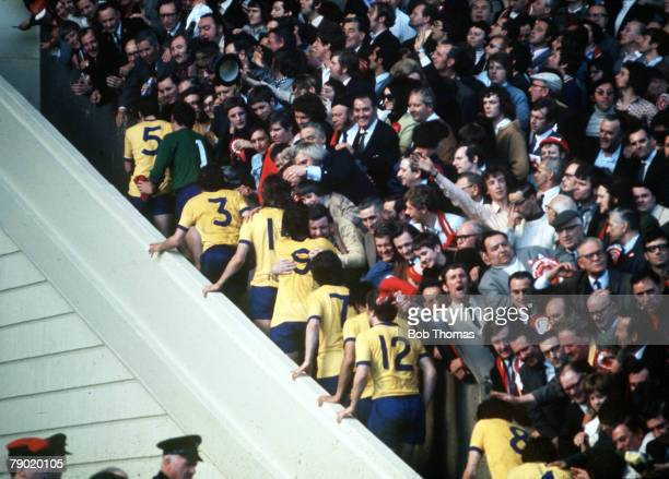 Football 1971 FA Cup Final Wembley Stadium 8th May Arsenal 2 v Liverpool 1 Arsenal players are mobbed by enthusiastic fans as they climb the famous...