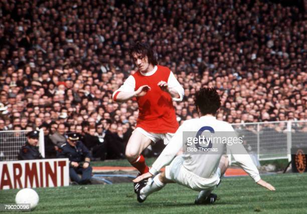 Football 1972 FA Cup Final Wembley Stadium 6th May Leeds United 1 v Arsenal 0 Arsenal's George Armstrong moves the ball past the challenge of Leeds...