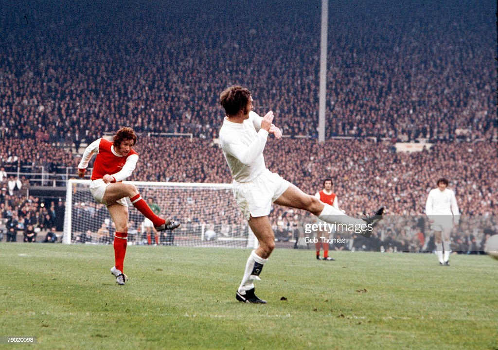 Football, 1972 FA Cup Final, Wembley Stadium, 6th May, 1972, Leeds United 1 v Arsenal 0, Arsenal's Alan Ball shoots past the challenge of a Leeds player