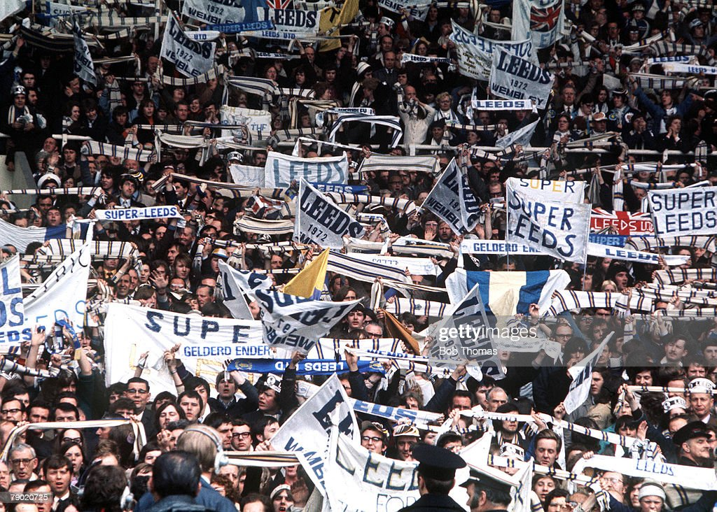Football. 1972 FA Cup Final. Wembley Stadium. 6th May, 1972. Leeds United 1 v Arsenal 0. A crowd of Leeds United fans waving scarves and banners during the match. : News Photo