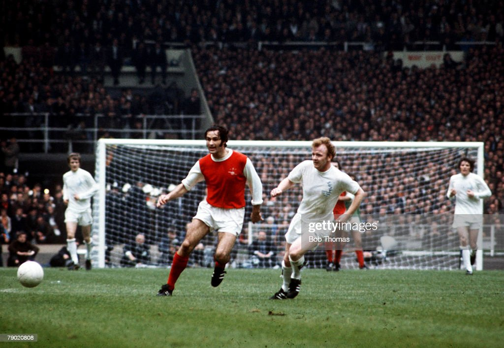 Football. 1972 FA Cup Final. Wembley Stadium. 6th May, 1972. Leeds United 1 v Arsenal 0. Arsenal's George Graham and Leeds United's Billy Bremner chase the ball. : News Photo