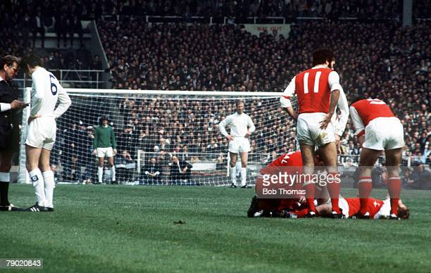 Football 1972 FA Cup Final Wembley Stadium 6th May Leeds United 1 v Arsenal 0 The referee books Leeds' Norman Hunter for a foul on Arsenal's Alan Ball