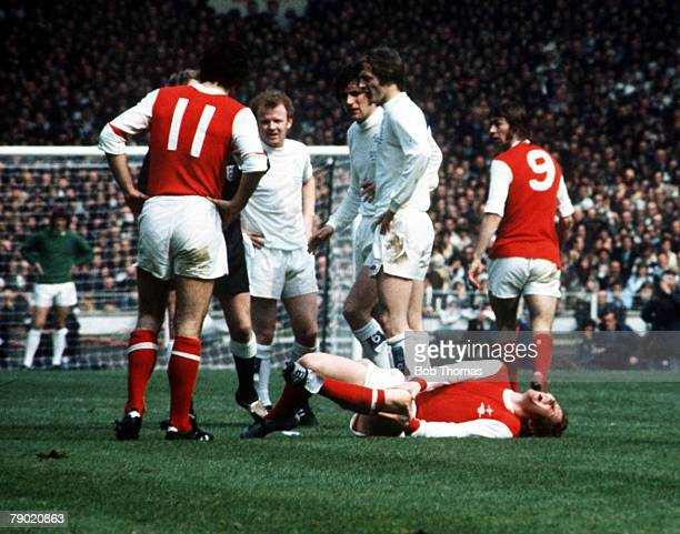Football 1972 FA Cup Final Wembley Stadium 6th May Leeds United 1 v Arsenal 0 The referee books Leeds United's Norman Hunter for a foul on Arsenal's...