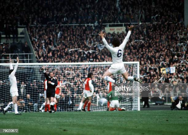 Football 1972 FA Cup Final Wembley Stadium 6th May Leeds United 1 v Arsenal 0 Leeds Uniteds Norman Hunter leaps into the air to celebrate as teammate...